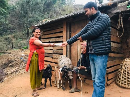 Happy-women-after-receiving-goats-for-her-livelihood